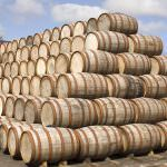 Stacked bourbon barrels outside a distillery.