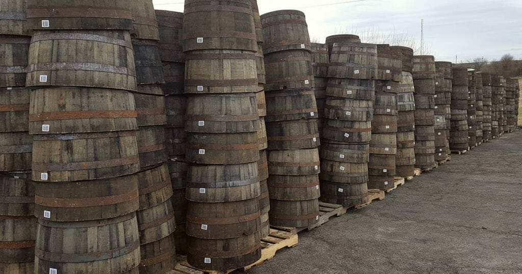 whiskey barrel planter on pallets awaiting shipment to garden centers, nurseries and hardware stores.